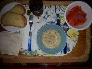 Oatmeal, papaya and thick slices of Italian bread, buttered and broiled with homemade jam.